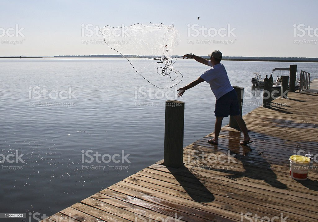 Fish Net Toss royalty-free stock photo