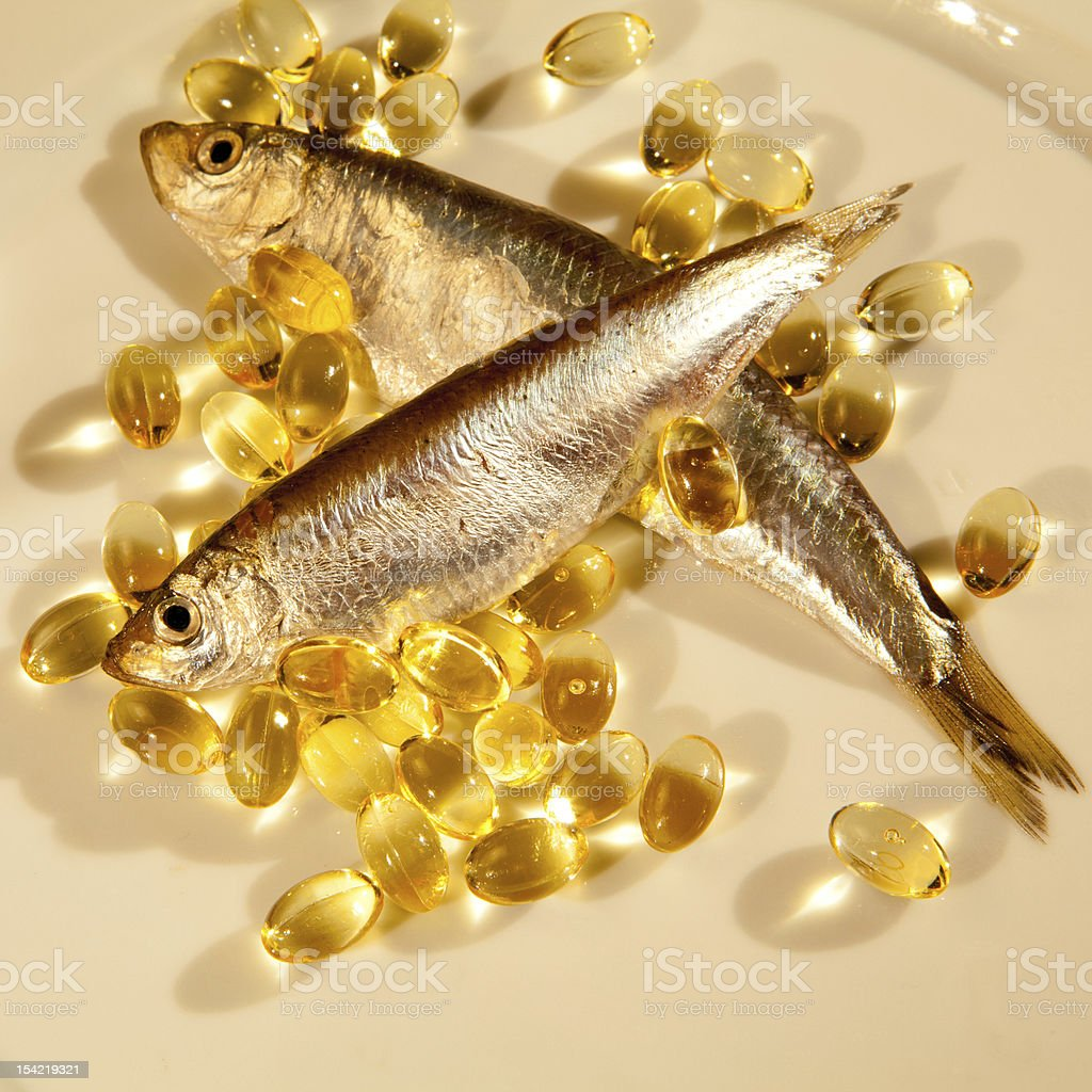 fish oil and sprat stock photo