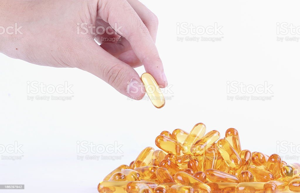 Fish oil capsule close up royalty-free stock photo