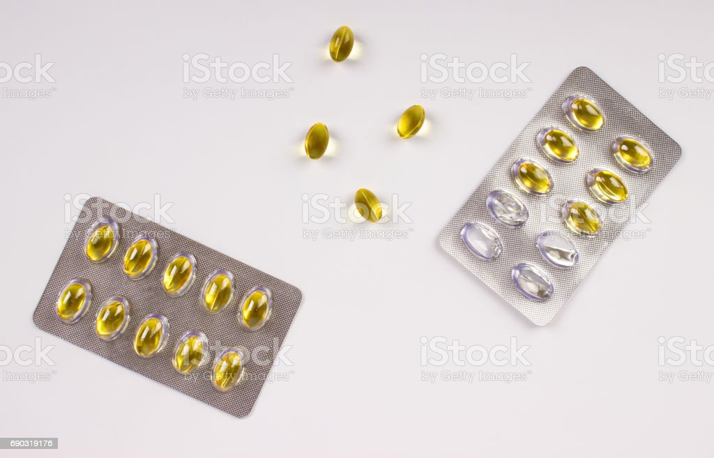Fish oil capsule isolated on white, health care. stock photo