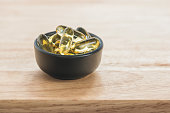 fish oil capsules in a bowl