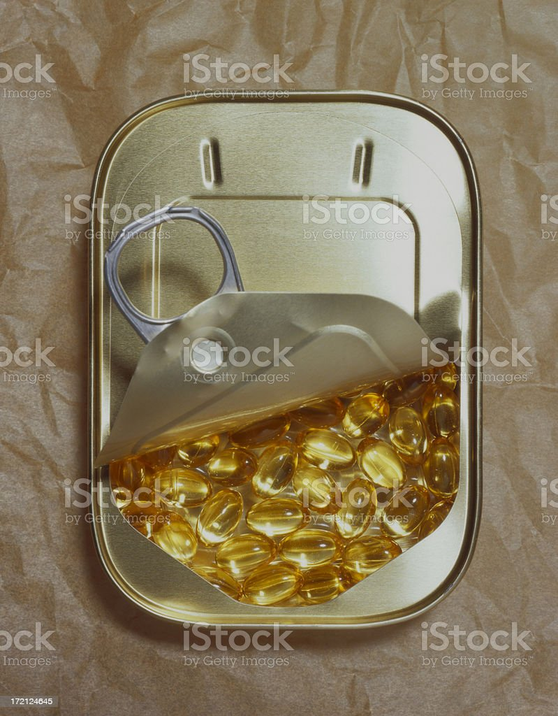 Fish oil capsules in a tin. royalty-free stock photo