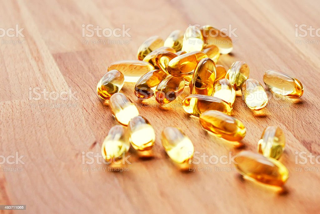 Fish oil capsules stock photo