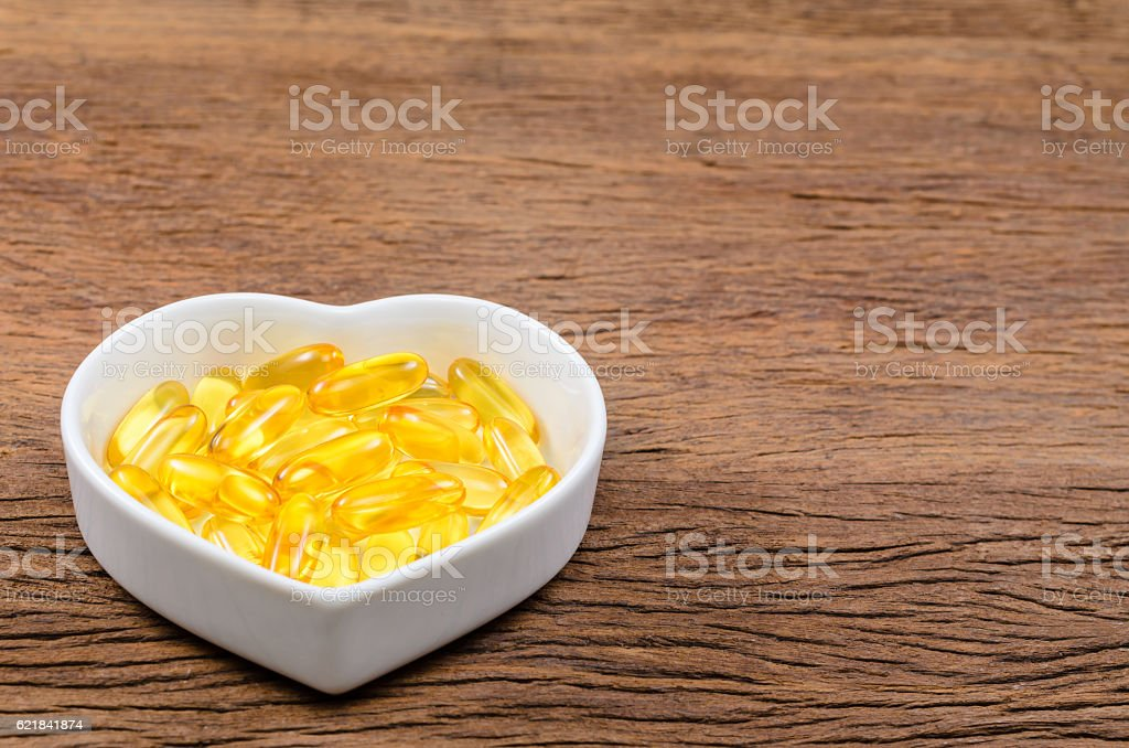 fish oil in heart shape bowl stock photo