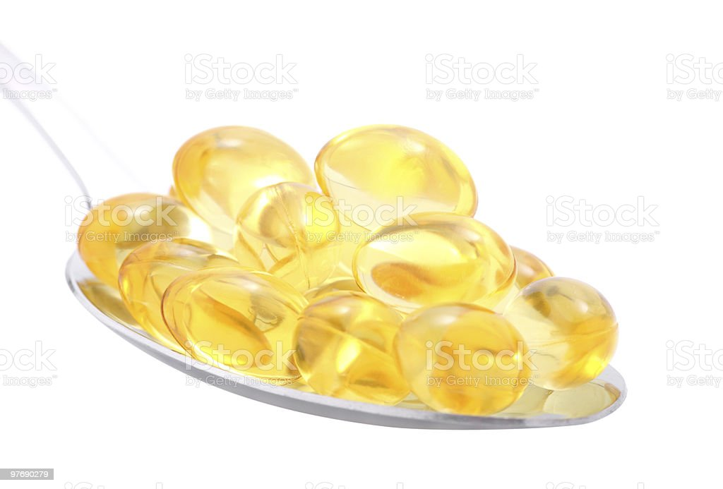 Fish oil in spoon royalty-free stock photo