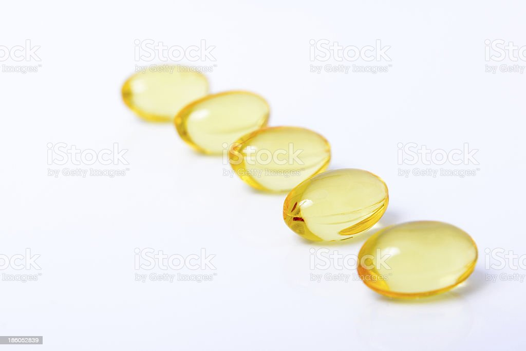 Fish oil nutritional supplement capsules royalty-free stock photo
