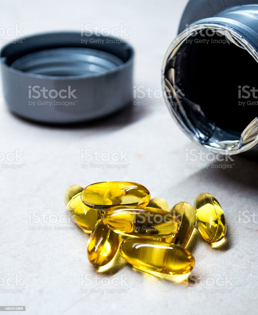 Fish Oil Pills/Capsules/Tabled in a Pile Close Up royalty-free stock photo