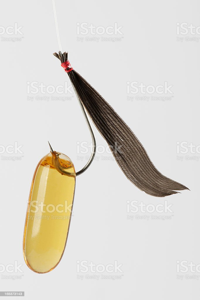 Fish Oil with Fishing Hook stock photo