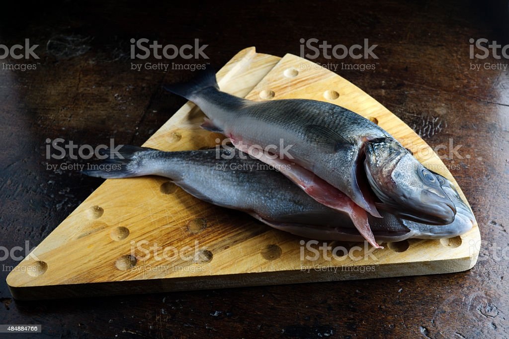 Fish on a brown old table, fish for cooking stock photo