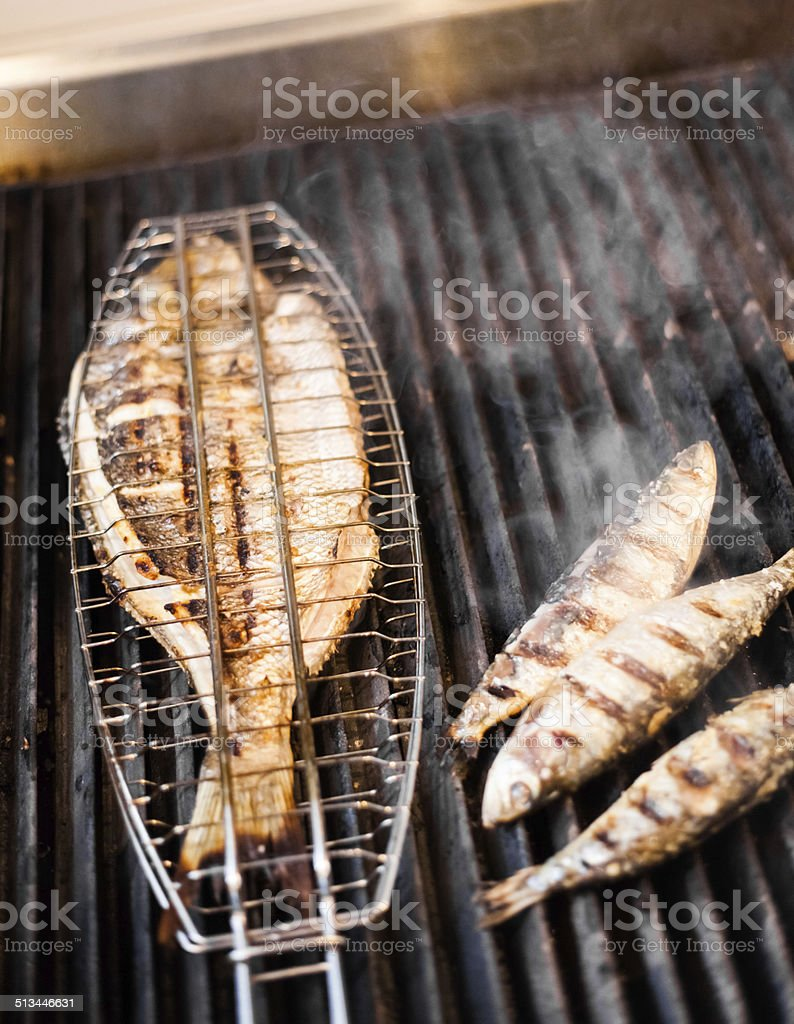 Fish on the grill stock photo