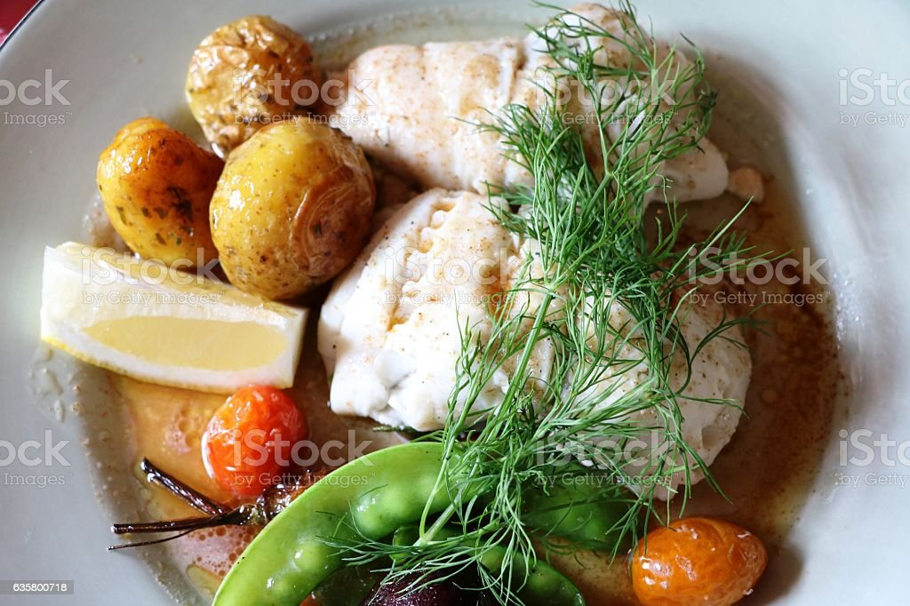 Fish pike perch with potatoes, beetroot and pea pods, Sweden stock photo