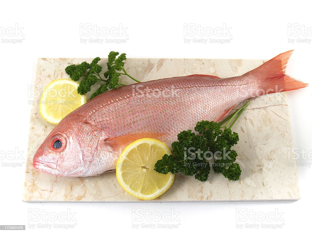 fish, raw red snapper with lemon and parsley stock photo