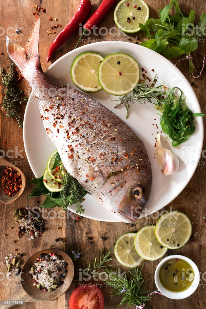 Fish raw with spices and herbs stock photo