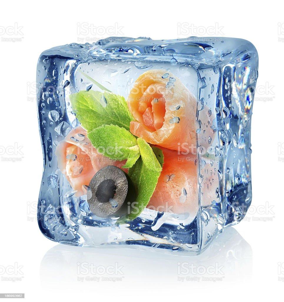 Fish rolls in ice cube stock photo