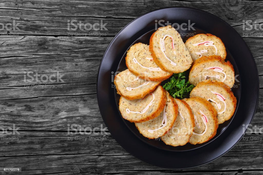 fish roll-up with crab meat cut in slices stock photo