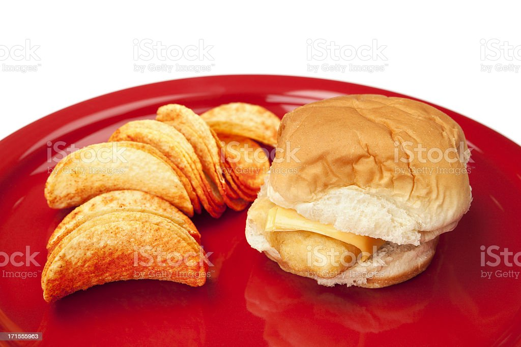 Fish Sandwich and Potato Chips Meal on Plate royalty-free stock photo