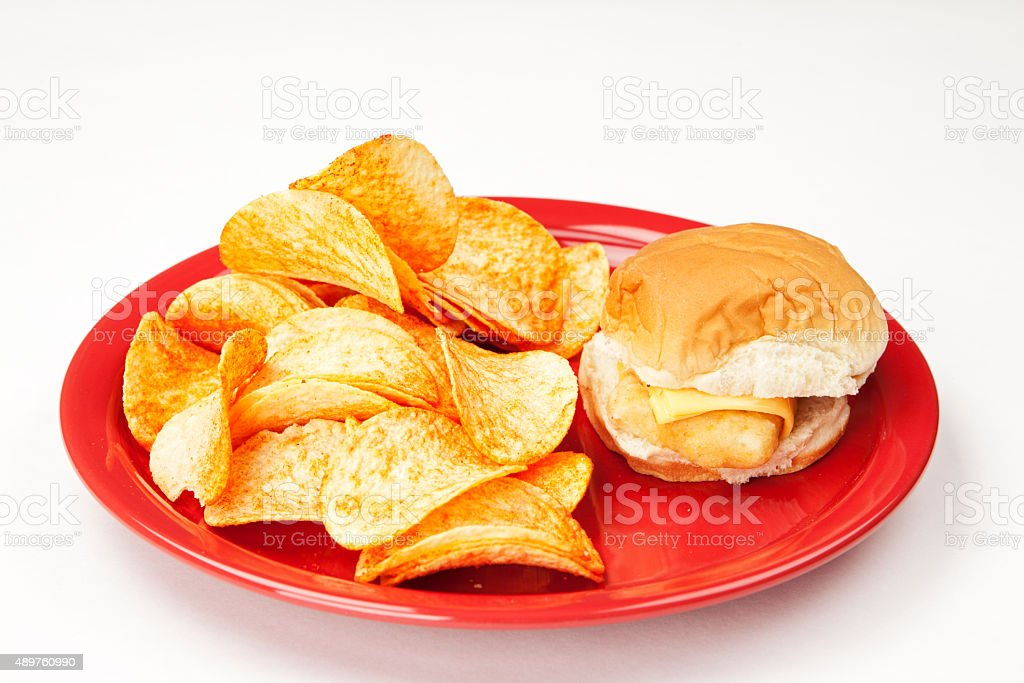 Fish Sandwich and Potato Chips stock photo