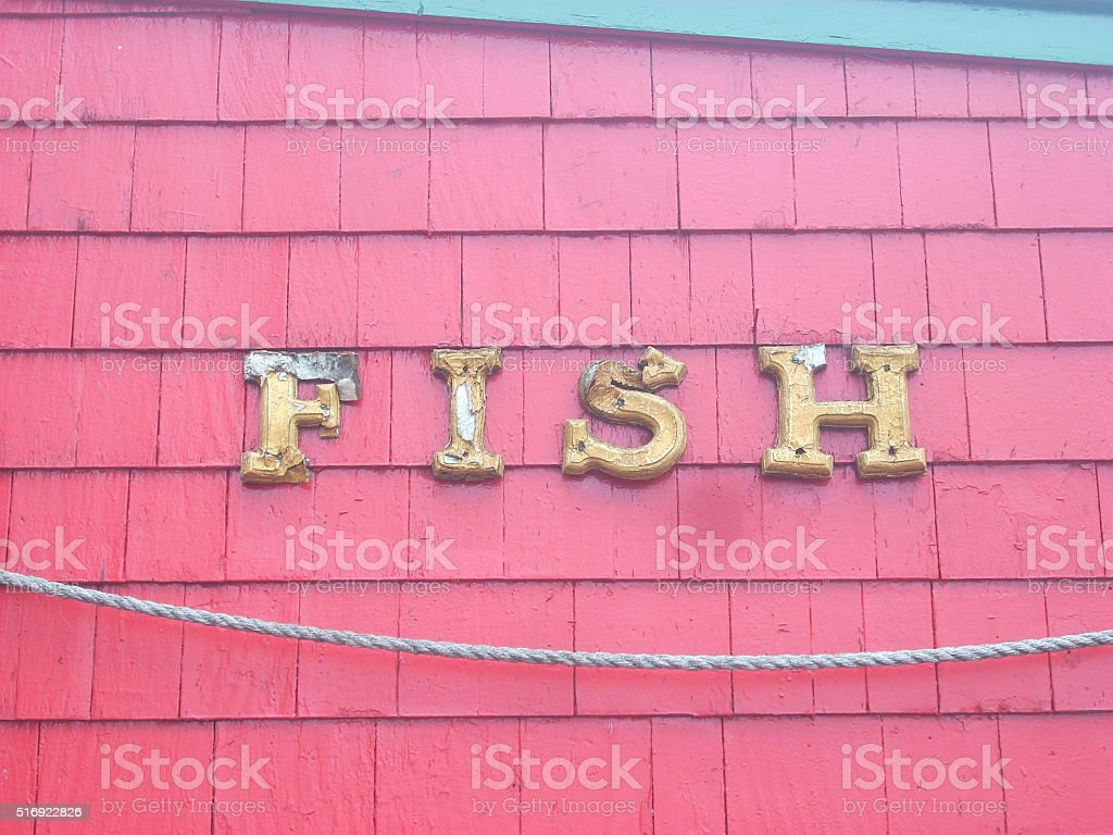 Fish Sign in Gold Lettering stock photo