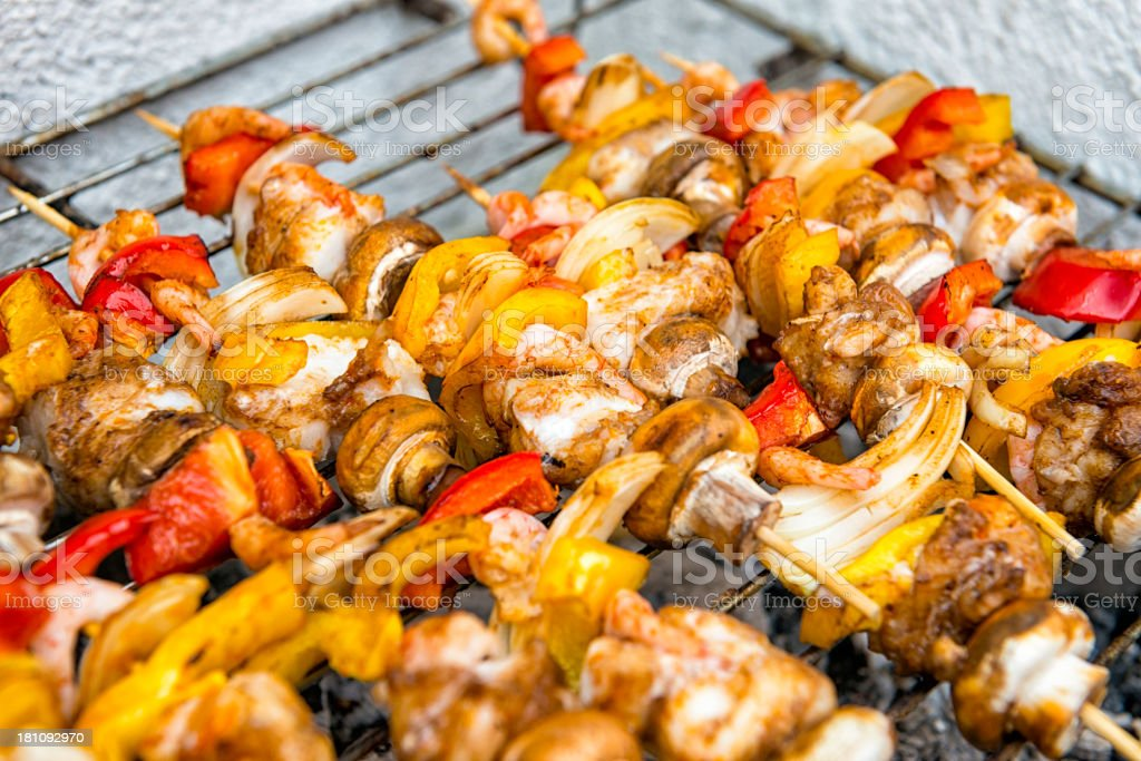 Fish skewers on the grill royalty-free stock photo