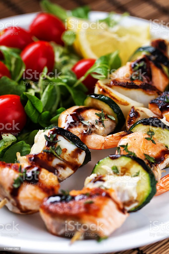 Fish skewers with salad stock photo