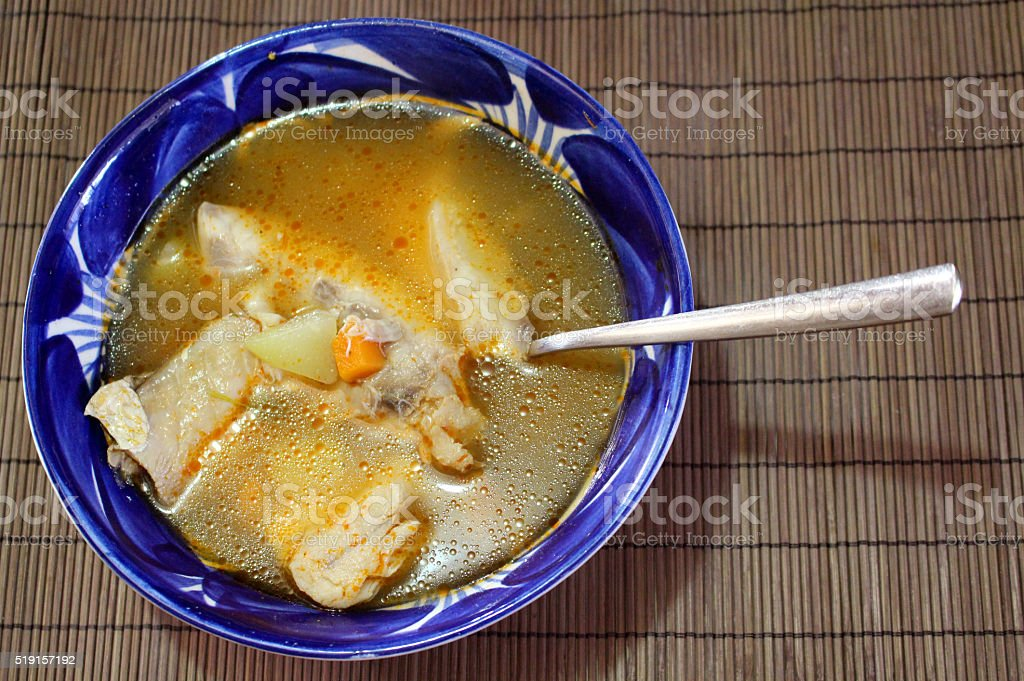 Fish soup in a bowl of Talavera stock photo