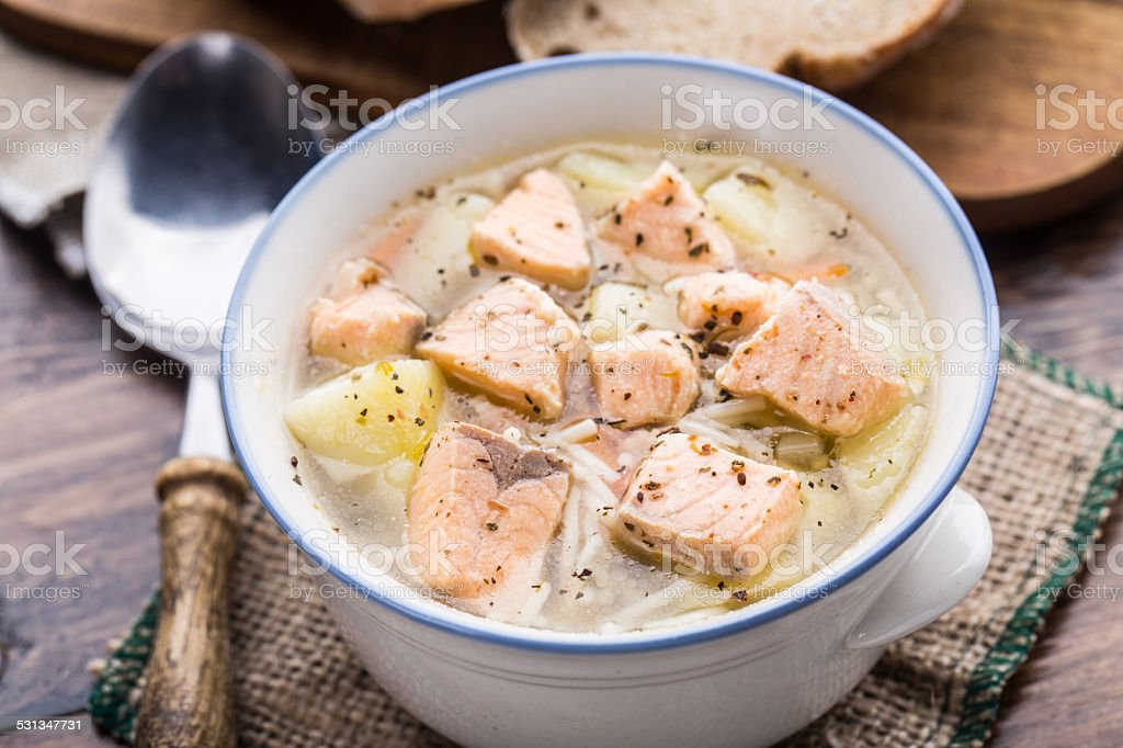 Fish soup in a bowl stock photo