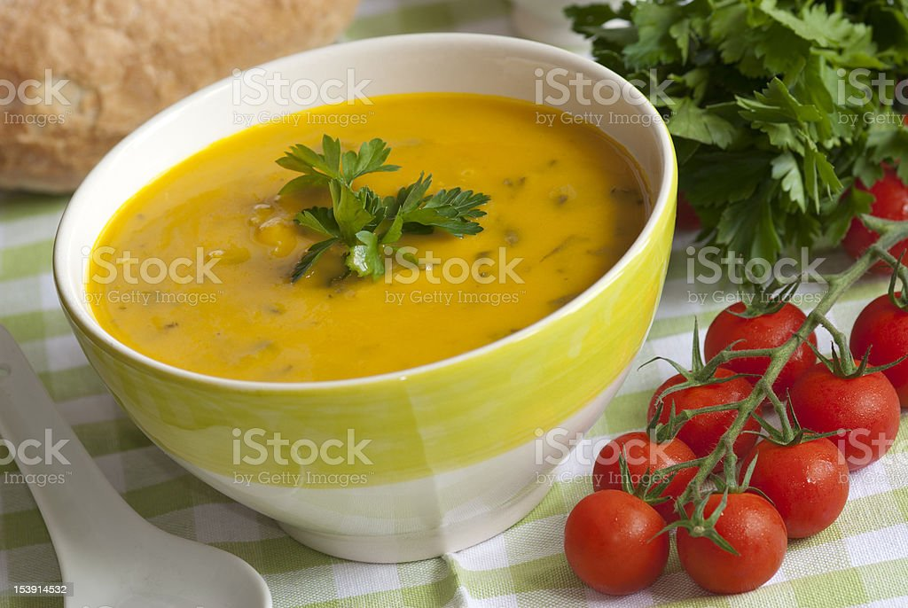 Fish soup in a yellow and white bowl stock photo