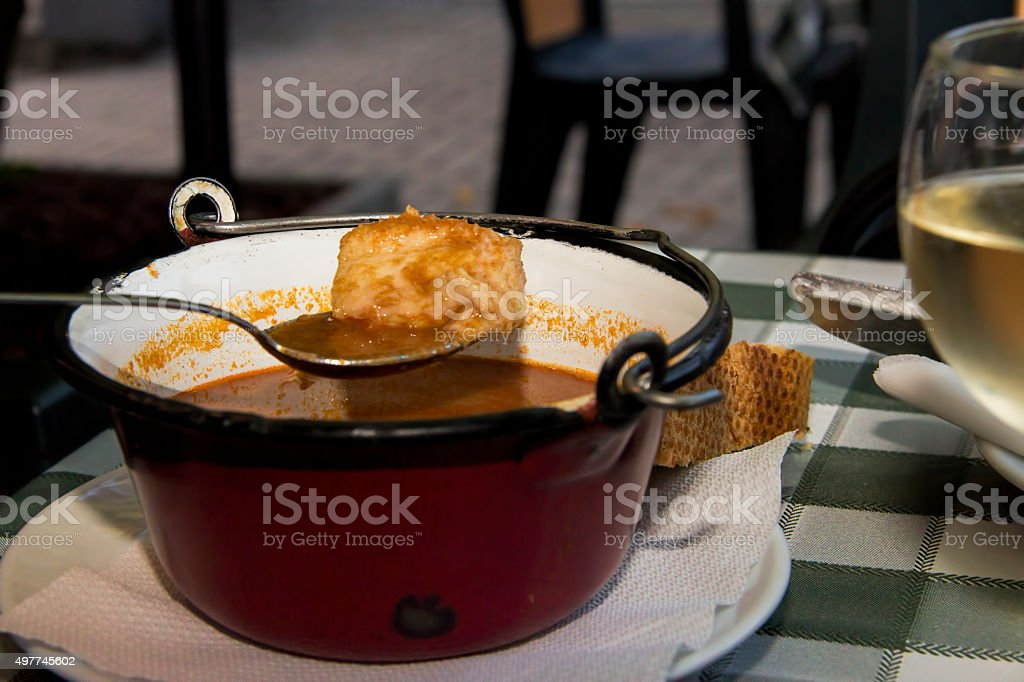 Fish soup in mini kettle stock photo