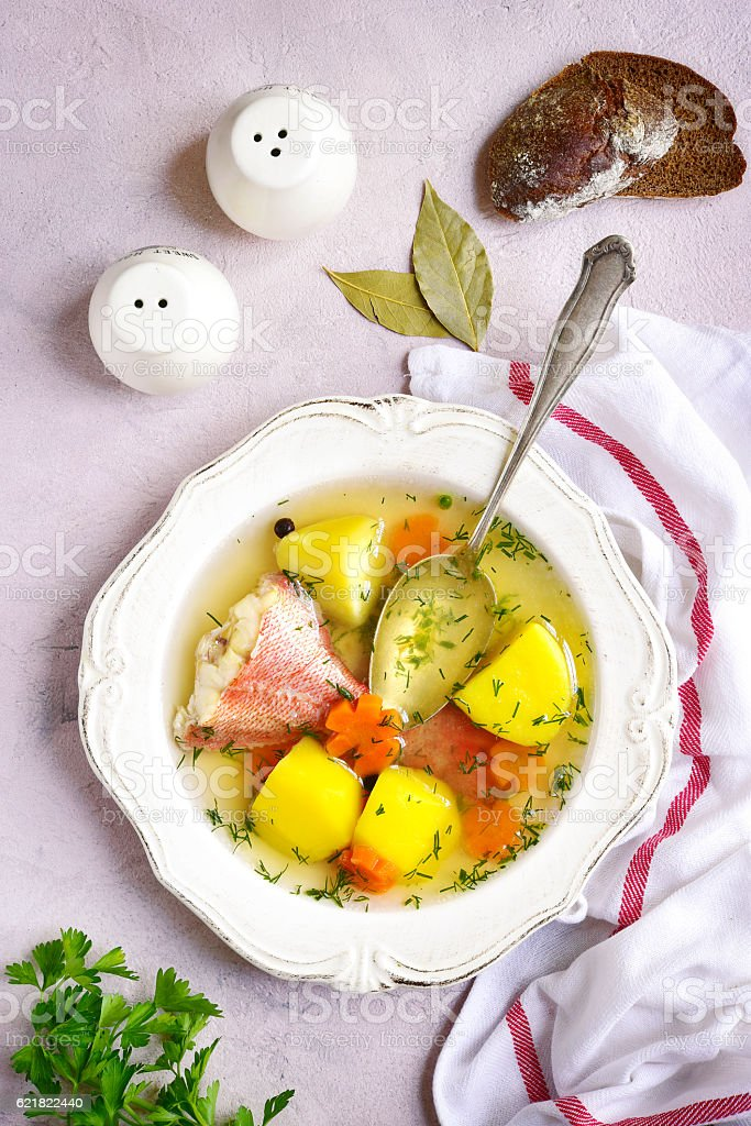 Fish soup with sea perch and vegetables.Top view. stock photo