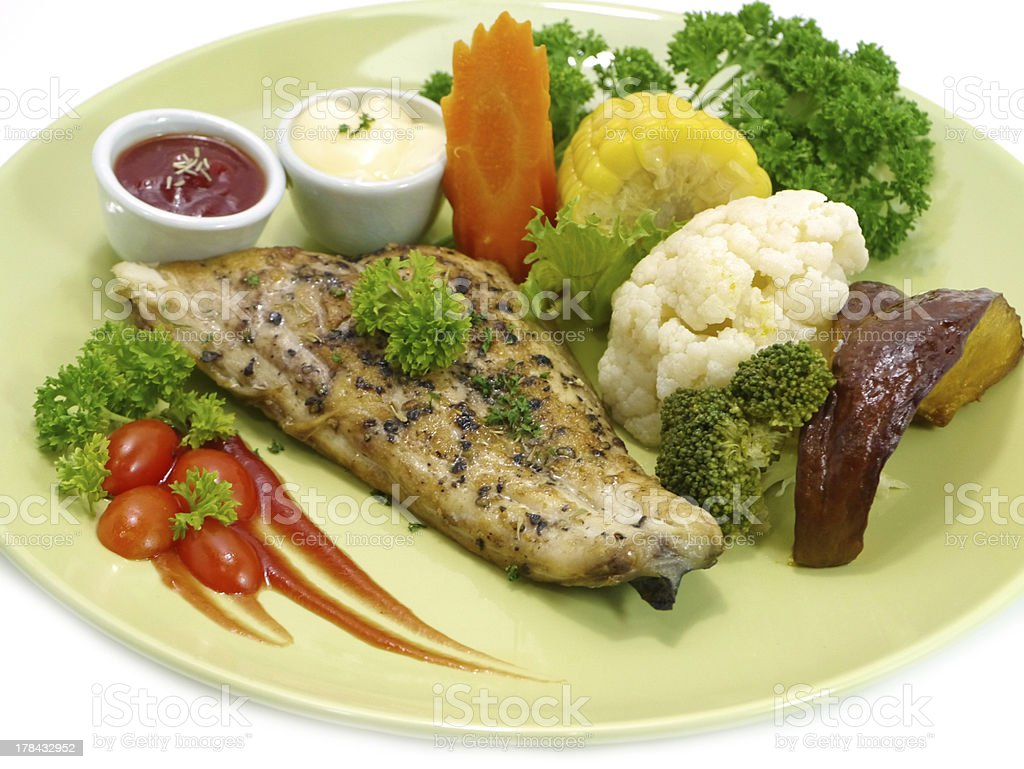 Fish steak with black pepper. royalty-free stock photo