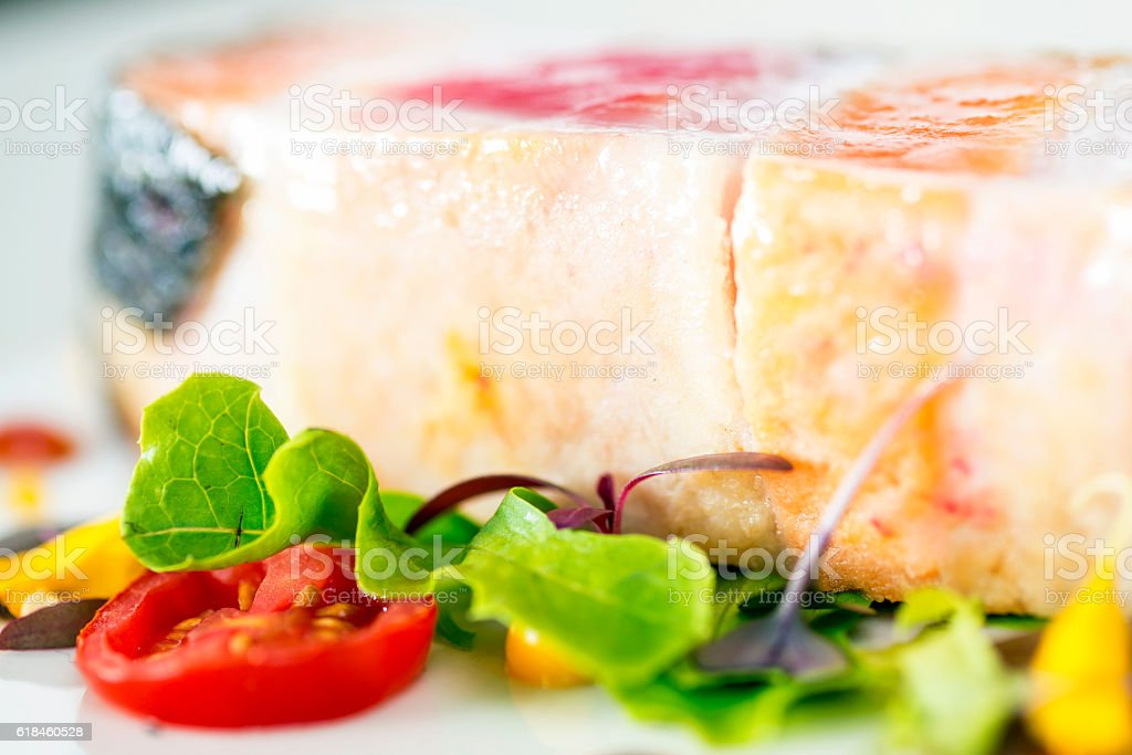 fish steak with vegetables ,grilled salmon steak slices stock photo