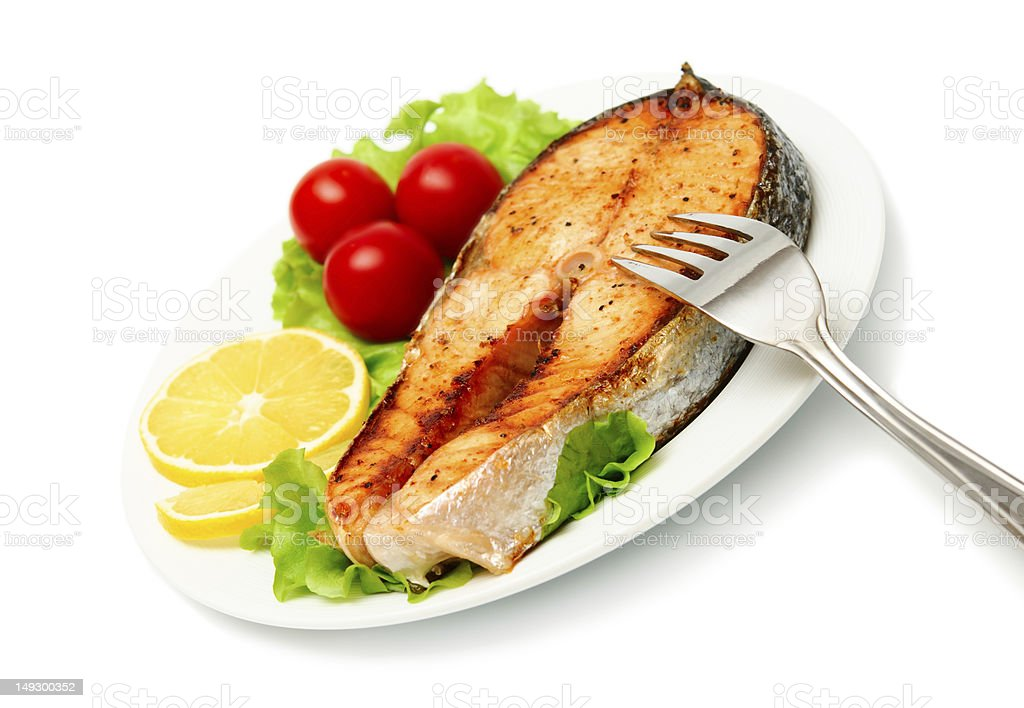 fish steak with vegetables on white background royalty-free stock photo