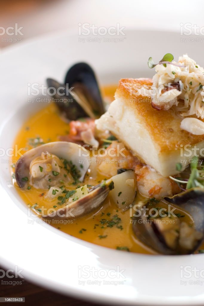 A fish stew with clams, mussels, shrimp in tomato sauce stock photo