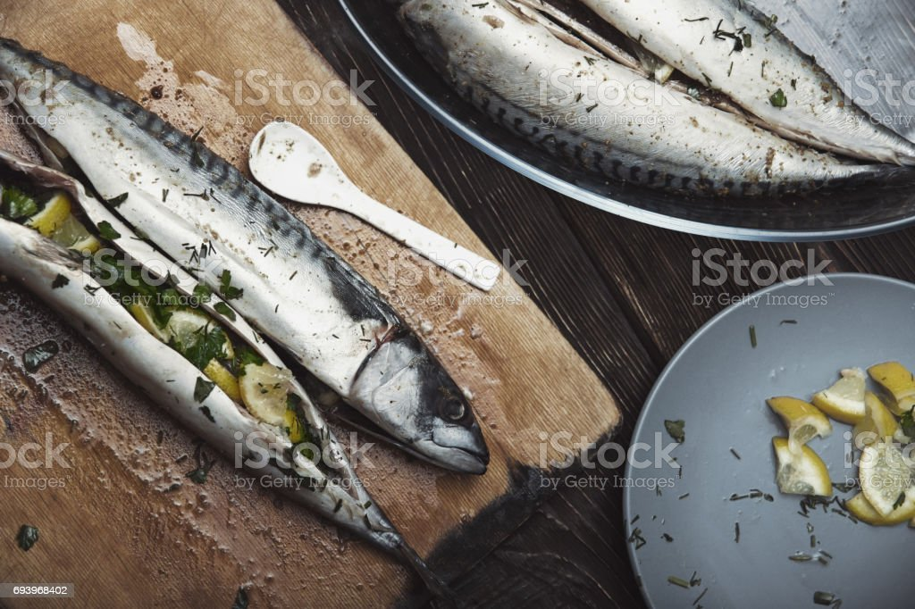 Fish stuffed by lemon and herbs with pepper stock photo