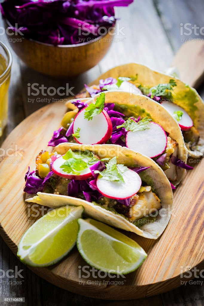 Fish tacoes on wooden background stock photo