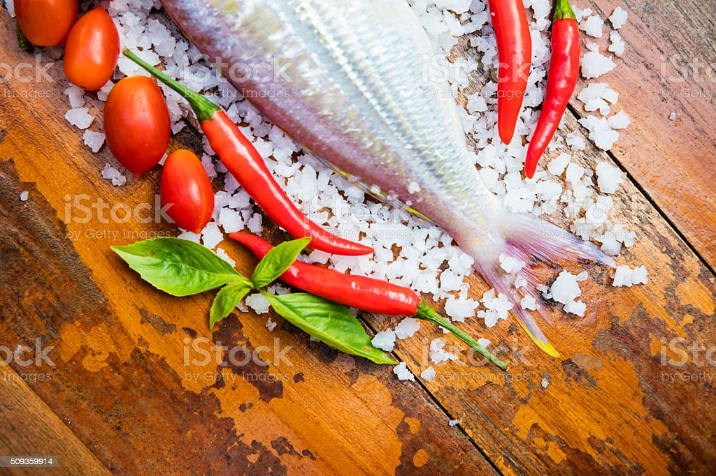 Fish  tail,sаlt, basil, tomato and red pepper stock photo