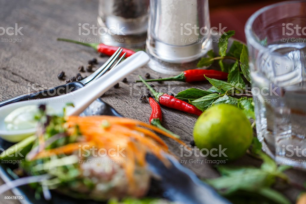 Fish tartare with herbs and carrot stock photo