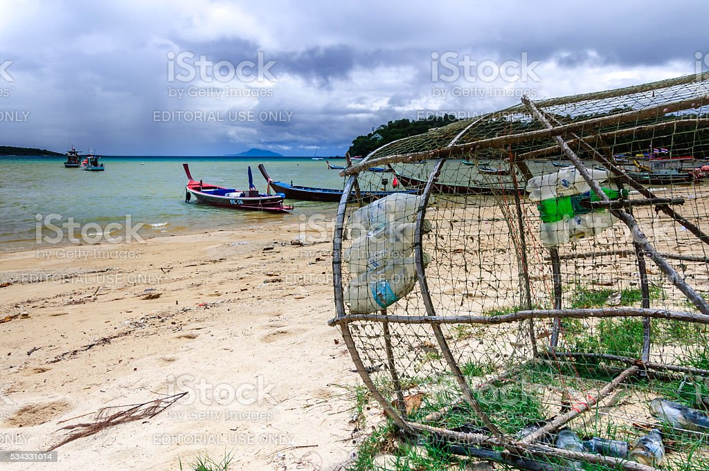 Fish trap & boats, Rawai beach, Phuket, Thailand stock photo