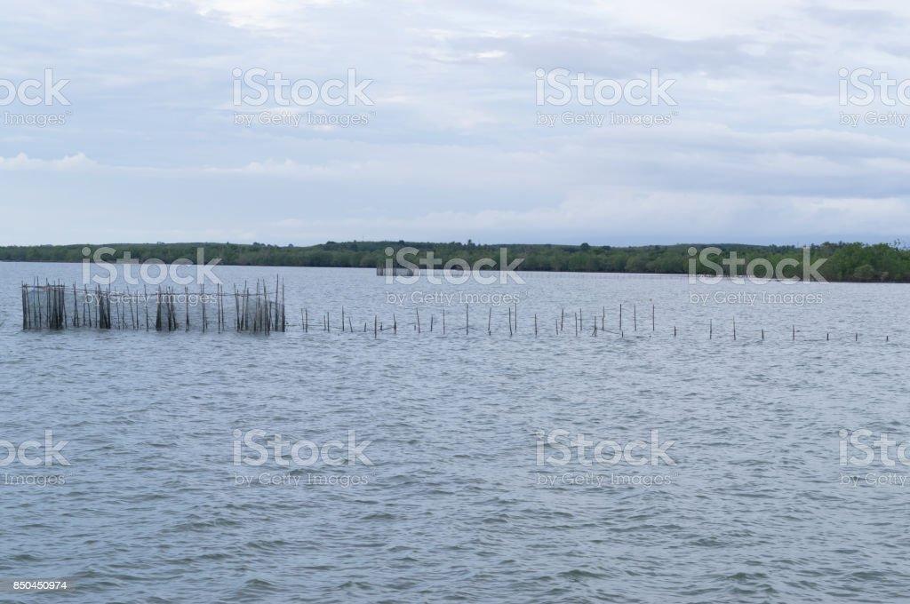 Fish trap in the sea stock photo