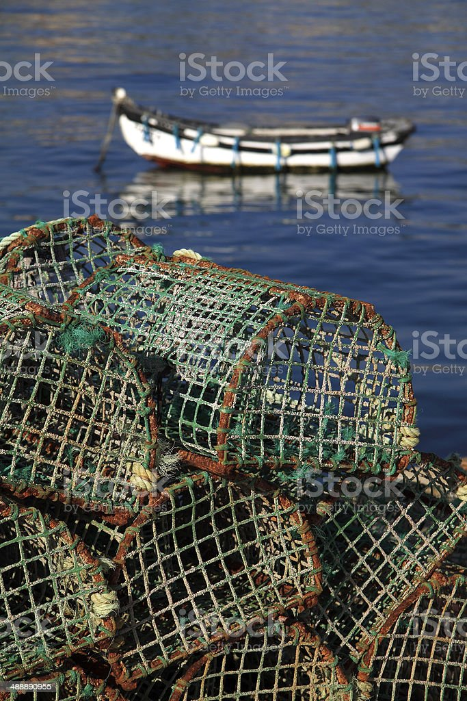 Fish traps with typical coastal fishing boat, Cascais Portugal. stock photo
