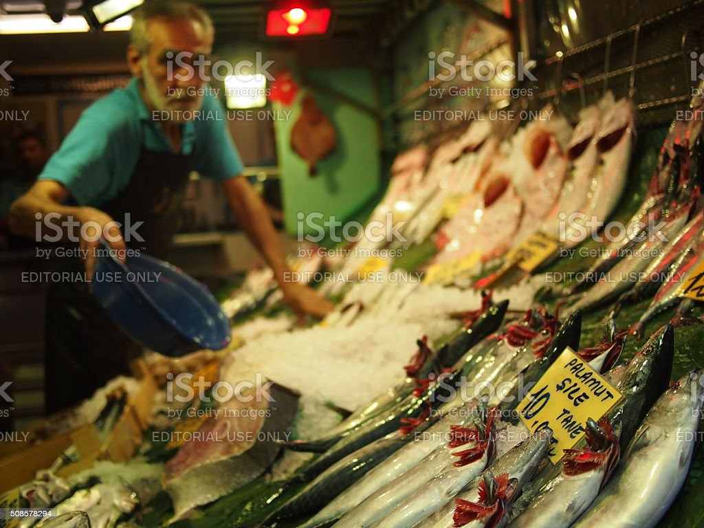 Fish vendor selling fresh fish stock photo