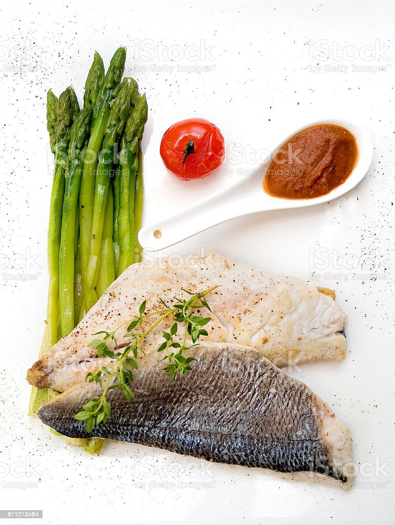 fish with asparagus stock photo