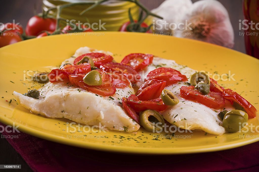 Fish with cherry tomatoes and olive. royalty-free stock photo