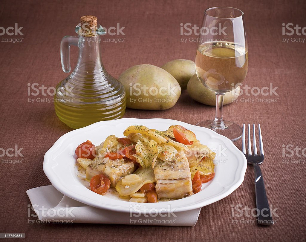 Fish with cherry tomatoes and potatoes. royalty-free stock photo