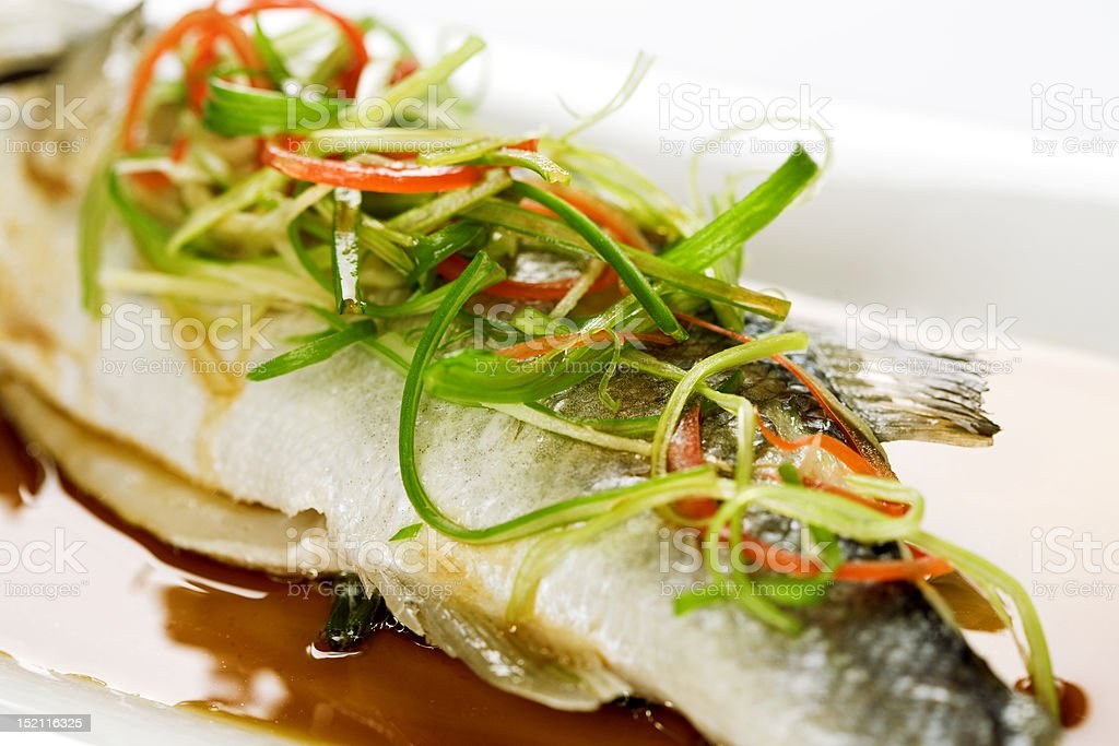 Fish with green vegetable royalty-free stock photo
