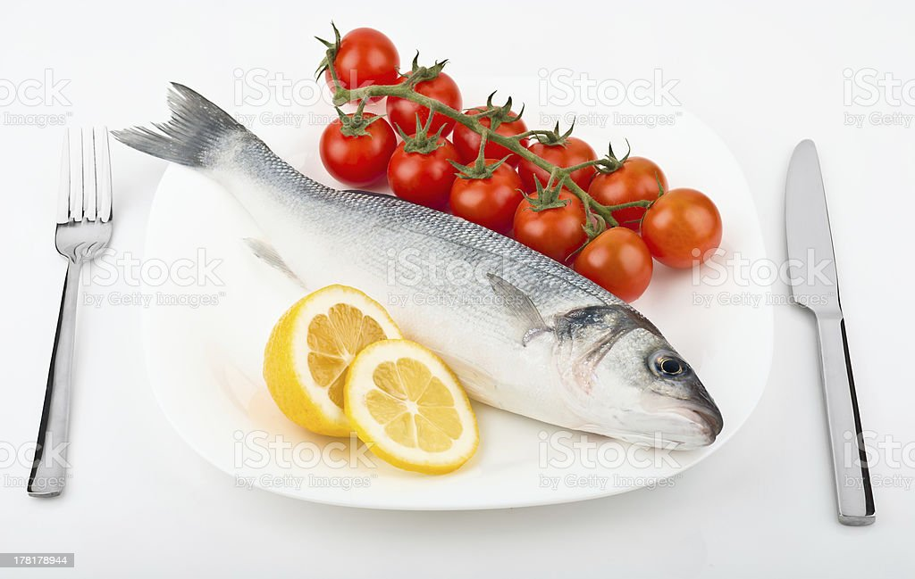 fish with lemon and tomato royalty-free stock photo