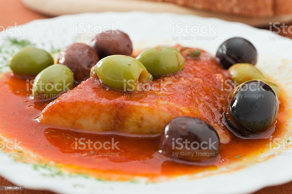 Fish with olives. royalty-free stock photo