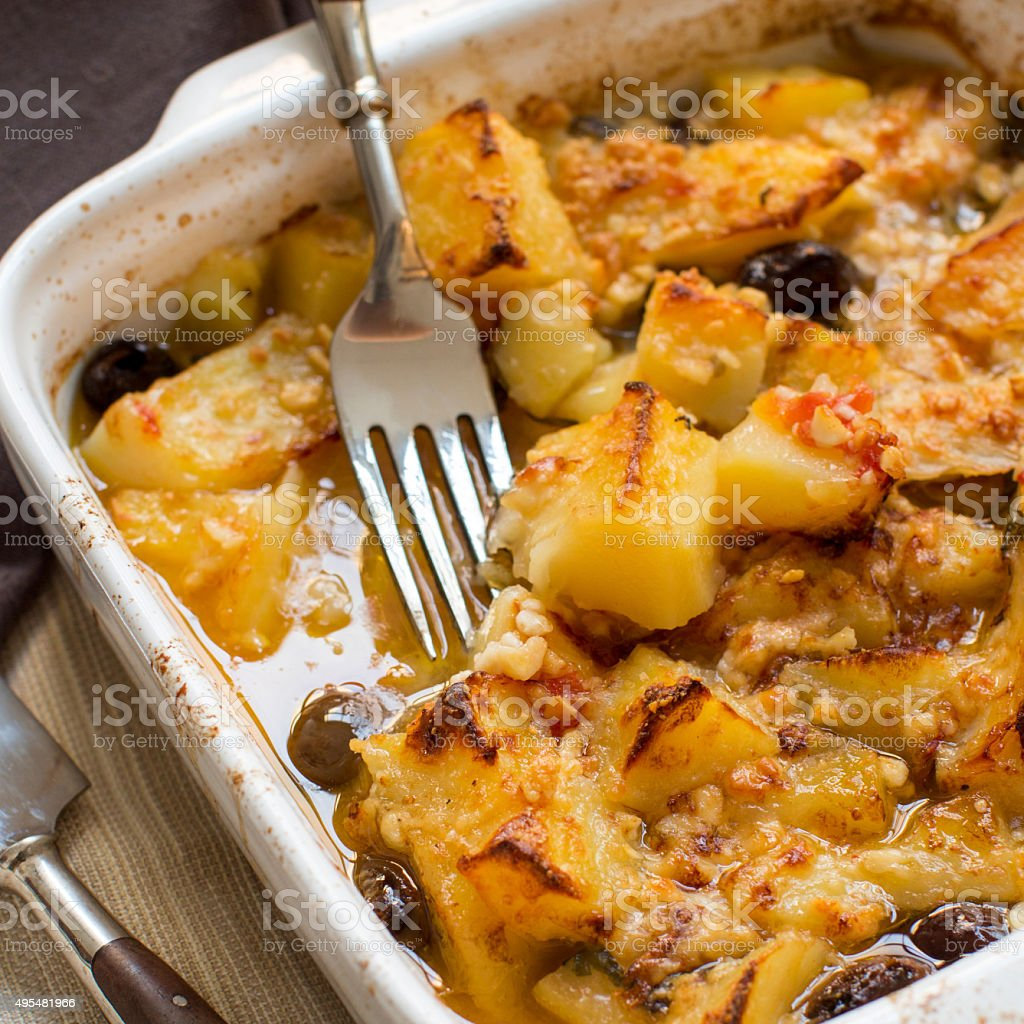 Fish with potatoes cooked in oven stock photo