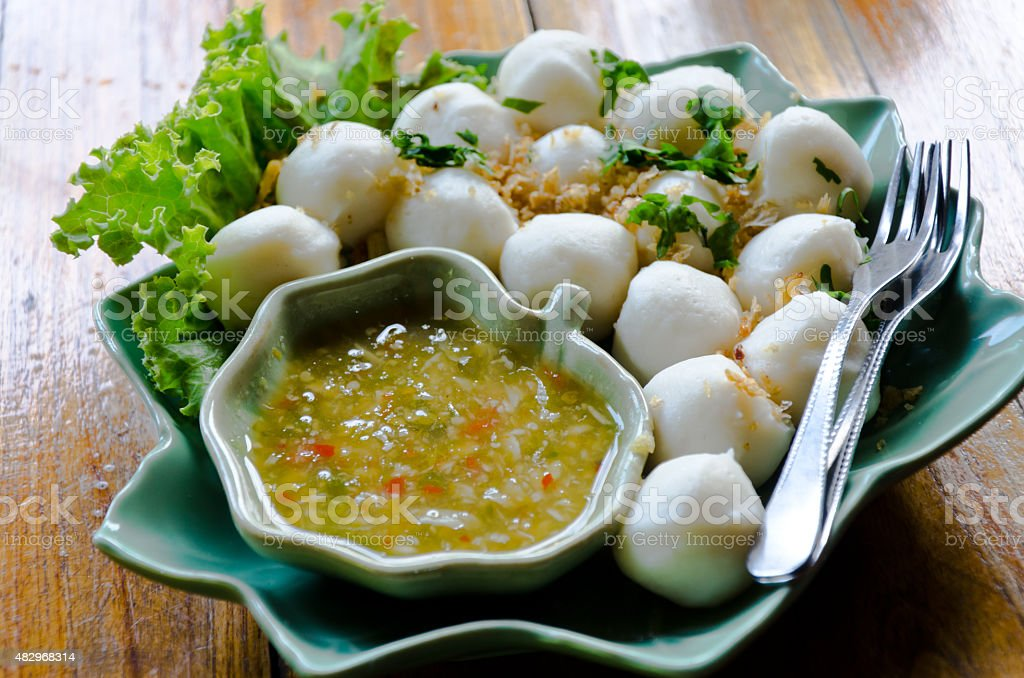 Fishballs with dipping sauce stock photo