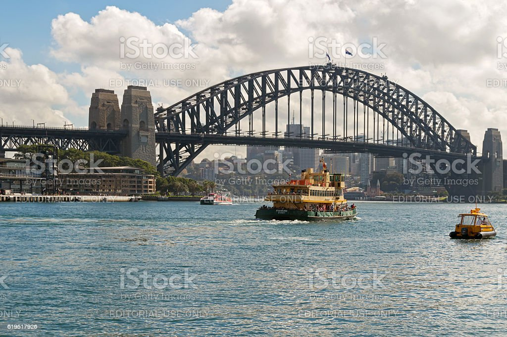 Fishburn ferry and other boats crossing under Sydney Harbour Bridge stock photo